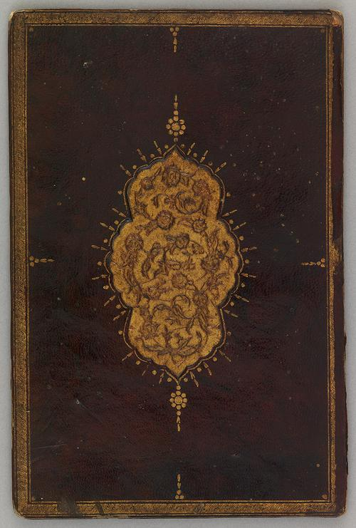 Outer cover of brown leather Turkish book binding. The border is decorated with a gilt rope and the centre contains a larger gilt embossed floral motif.