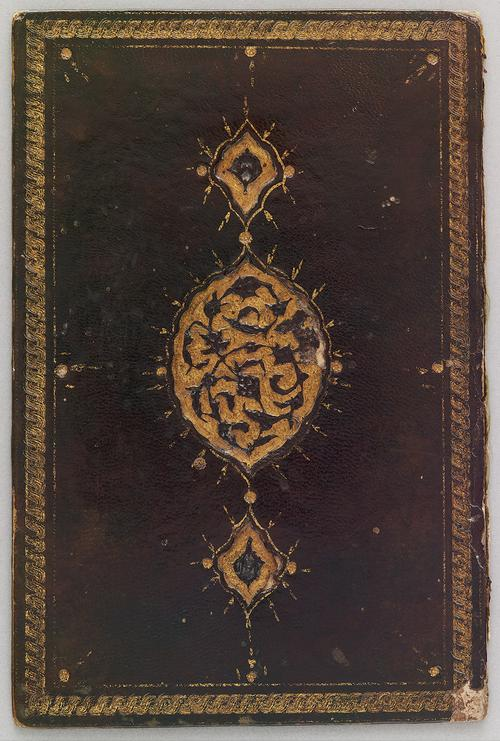 Single bookbinding cover, leather decorated with a gold boarder and a central recessed gold oval medallion with pendants, and the medallion is filled with a stamped design of flowers and leaves on curving branches.