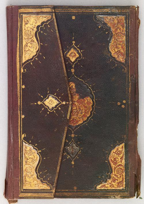 Front cover of dark-brown Turkish book binding closed with flap, gilt-stamped gold border and a centre gold and red medallion. Similar corner motifs as Centre medallion.