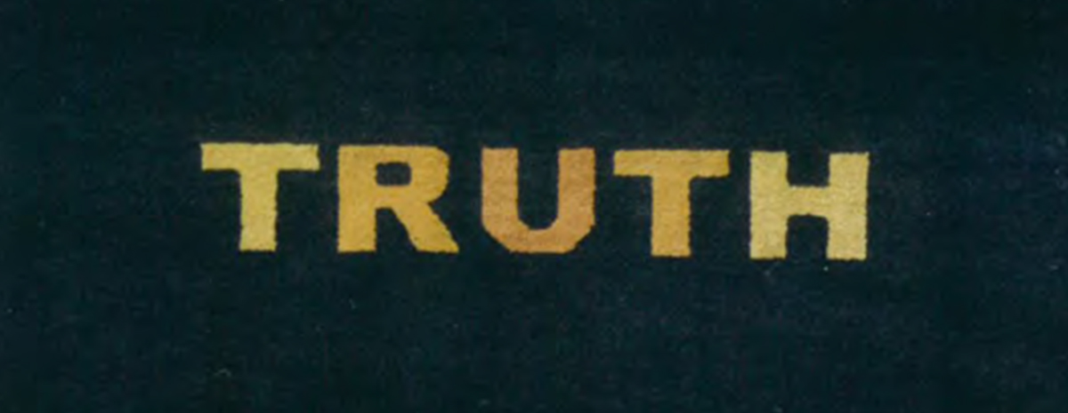 The word truth in amber letters against a black backdrop.