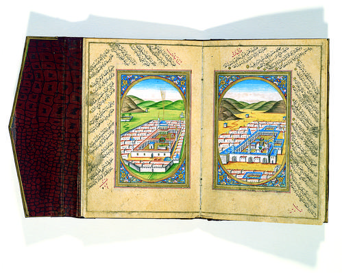 Double-page depicting Mecca on the right and Medina on the left side, each inserted in a gold ovoid border with floral motifs decorating the four corners of the composition. Both holy sites are rendered as a bird's-eye view with similar organization.