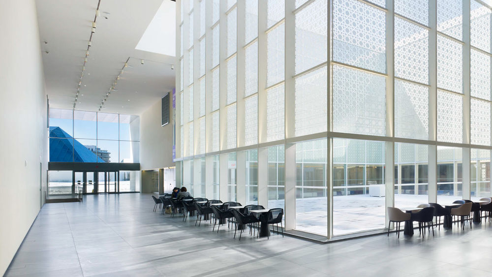 The modern architecture of the Aga Khan Museum is seen in a photo of its interior atrium.