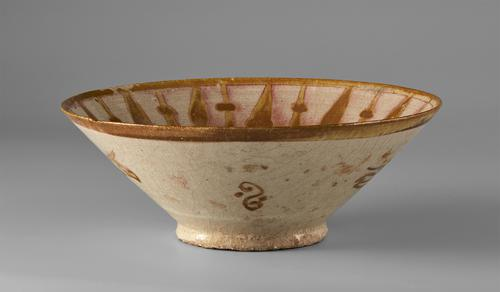 Beige bowl with a brown plain band around the rim, the exterior with a singular section of the scrolling floral motif