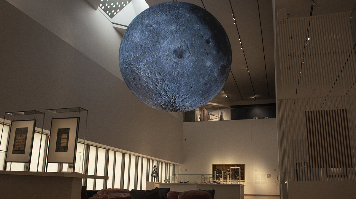 A sculpture of the moon hangs between the Museum's first and second floor.