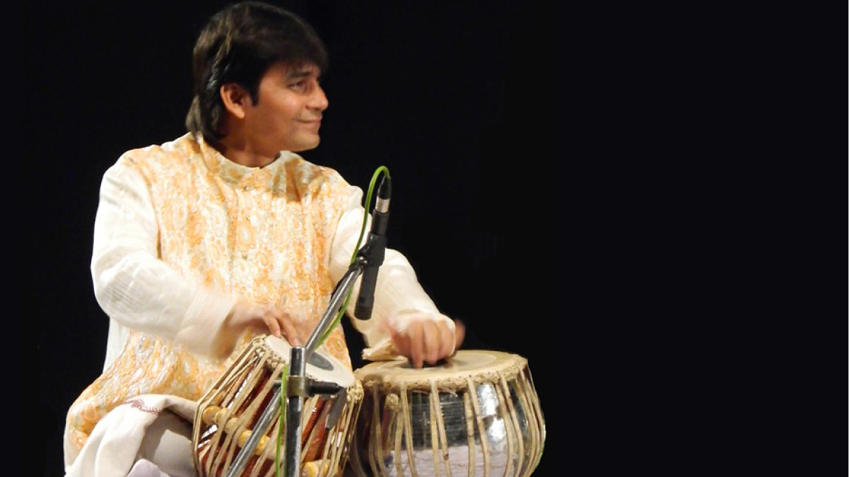 Sri Soumen Nandy, dressed all in white, plays the table drums.
