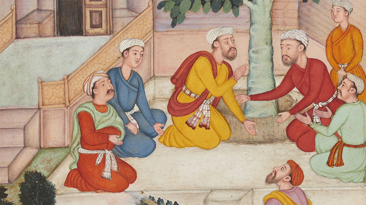 Two men in a courtyard converse beside a tree as five other men watch.