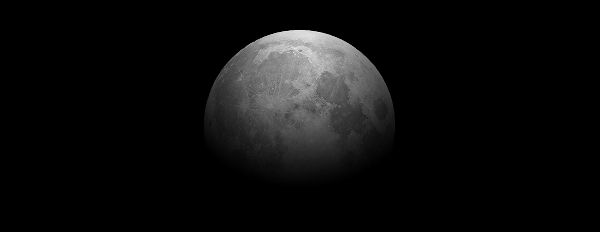 A greyed out  moon faded into a black background.