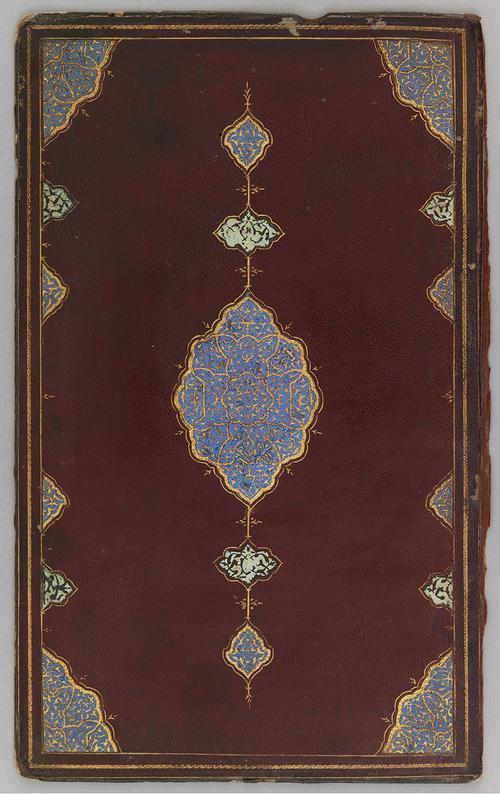 Front cover of Iranian bookbinding of mahogany-coloured leather. Thin spiral golden border. Large blue medallion motif in the centre with fine golden work. Similar blue motif is repeated in each inner corner of the border.